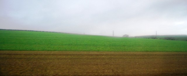 Fallow  land and crops by the A35