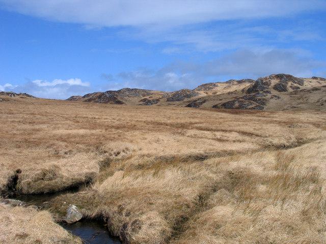 Grassy moorland rising to Cruach na Seilcheig