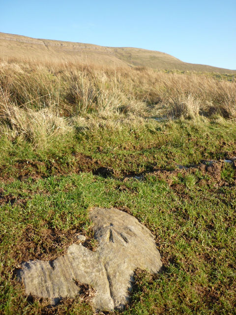 Bench mark in embedded rock, footpath on Meikle Awfell