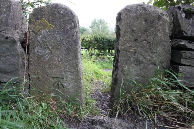 Benchmarked stone stile beside A684