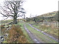 SD9121 : Foulclough Road and the remains of the Moorcock Inn by John Slater