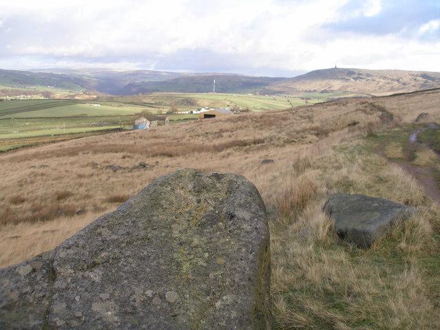 Rock with rivet benchmark beside the Pennine Bridleway