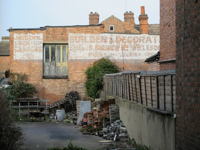 Former builder's yard with ghost sign, off Crownhill Road, NW10