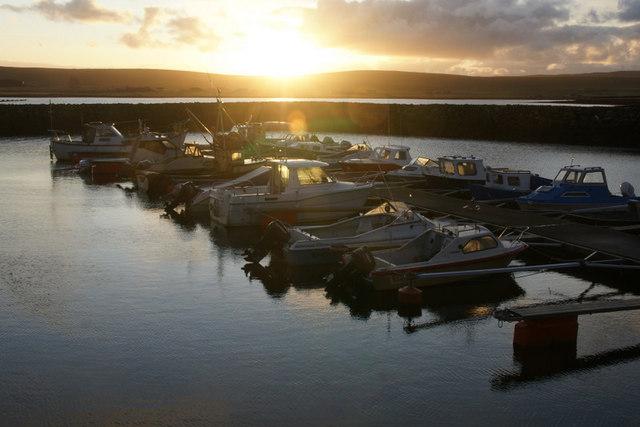 Baltasound marina at sunset
