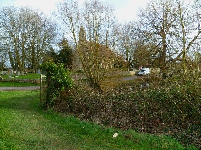 Pond and church at Hunston