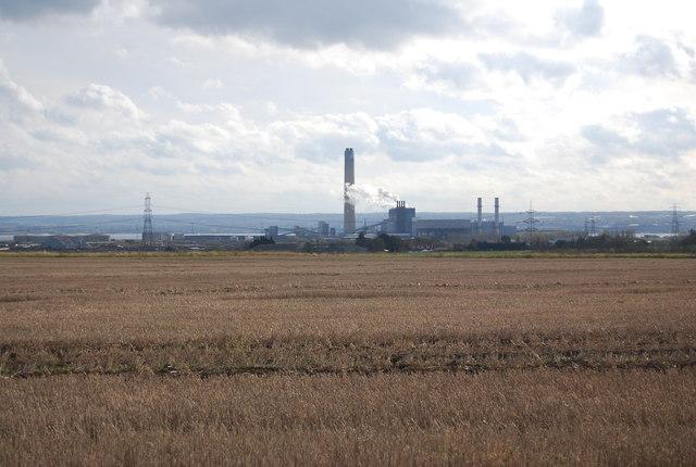 Kingsnorth Power Station across a stubble field