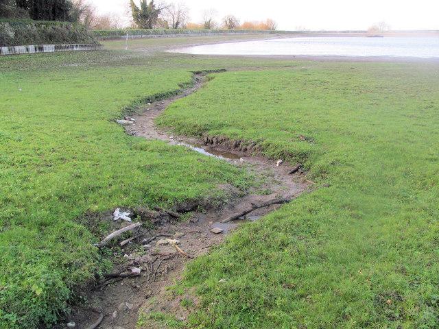 The dry stream bed feeding Startops Reservoir