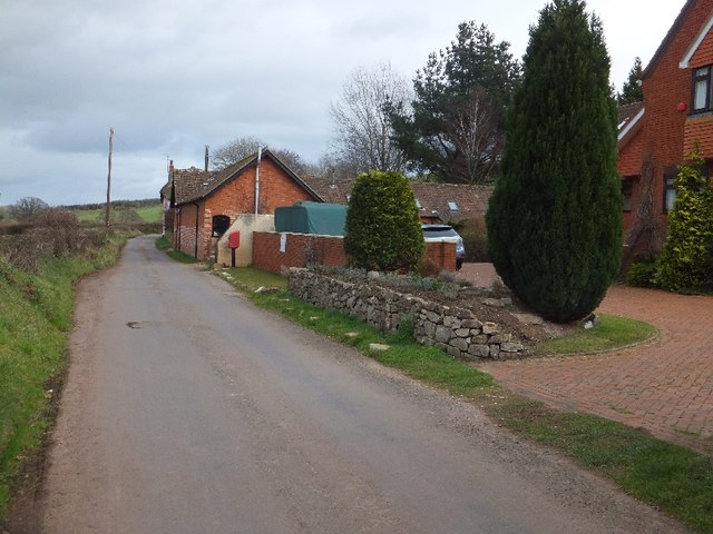 Road passing Oakdene farm buildings