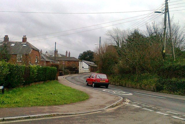 The main road through Exminster, at the junction with Glebelands