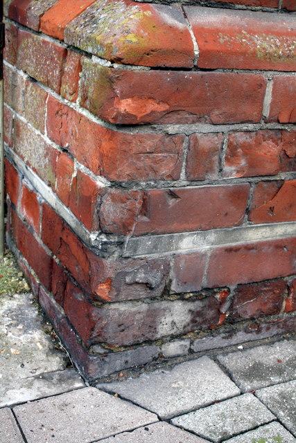 Worn benchmark on the Customs House, Castletown
