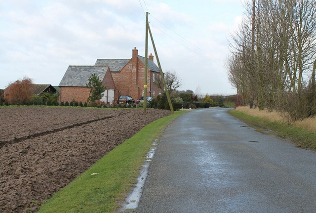 House on Sea Dyke with ploughed field