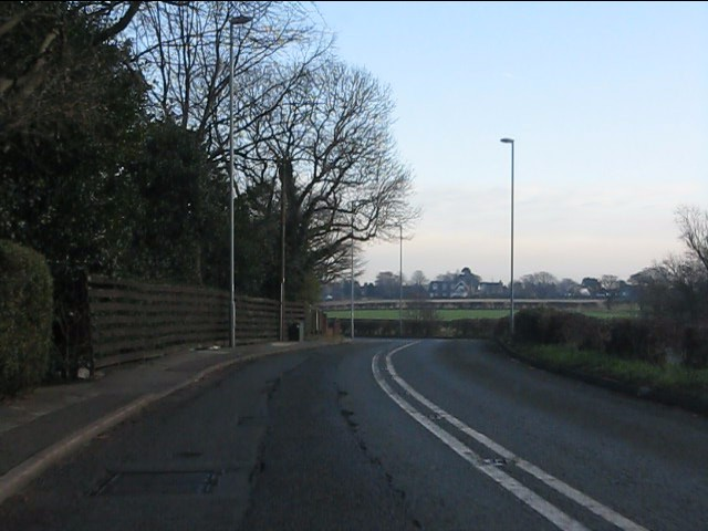 Chester Road (A56) curving alongside the Bridgewater Canal