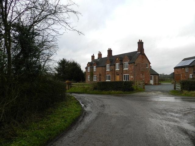 Red brick house on a lane by Bradley