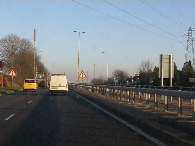 Power lines cross the A580