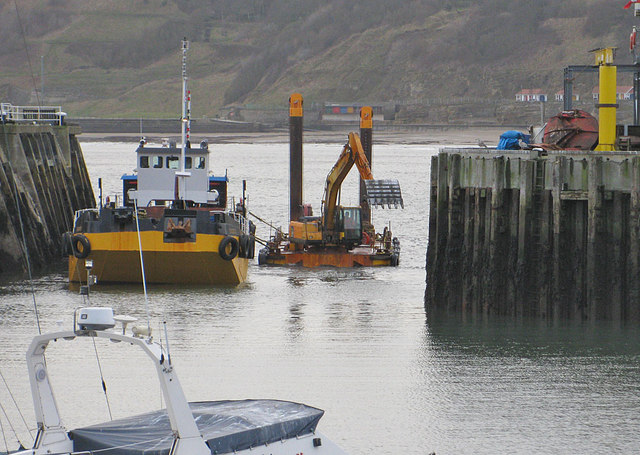 Dredger at work in the harbour entrance, Scarborough