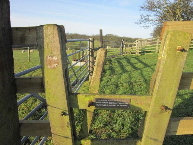 Stiles near Kiddal Hall Farm