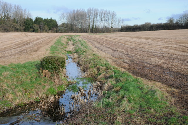 Stream passing through a stubble field