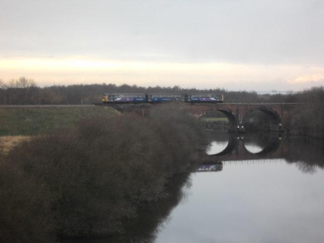 Castleford bound train crossing river Calder.