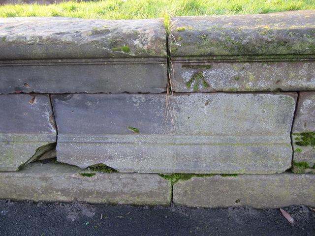 Bench mark on a former fountain in Newsham Park