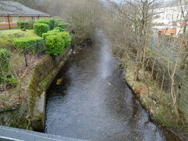 Rhondda Fawr river flows towards a road bridge near the A4061, Ynyswen