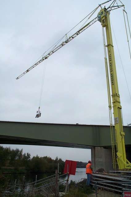 "A ""John Sutch"" Crane aiding the construction of the Motorway bridge."