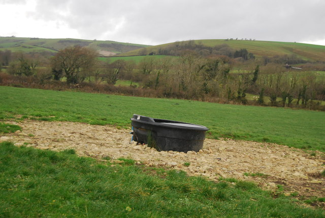 Water trough in a field