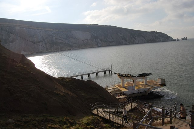 Chairlift, pontoon and wooden steps to the beach at Alum Bay