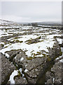 SD7777 : Snow covered limestone pavement near Rigg Barn by Karl and Ali