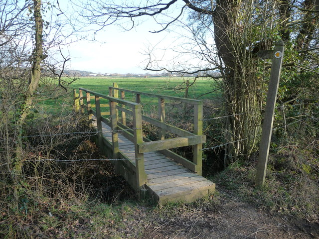 Footbridge and footpath across fields