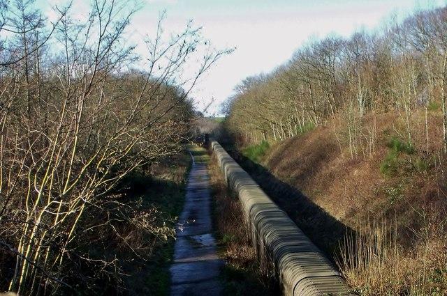 Enclosed conveyor belt near Brightling
