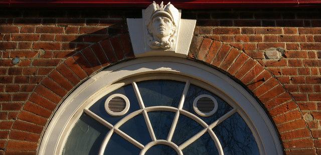 Sculpted keystone, former post office, Kew
