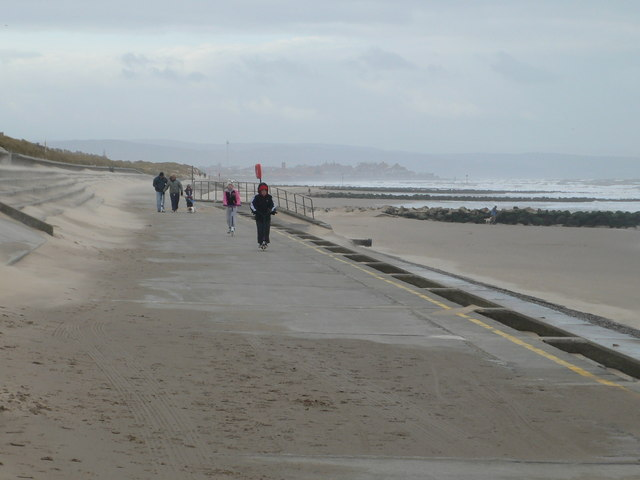 Family walk on the prom at Prestatyn