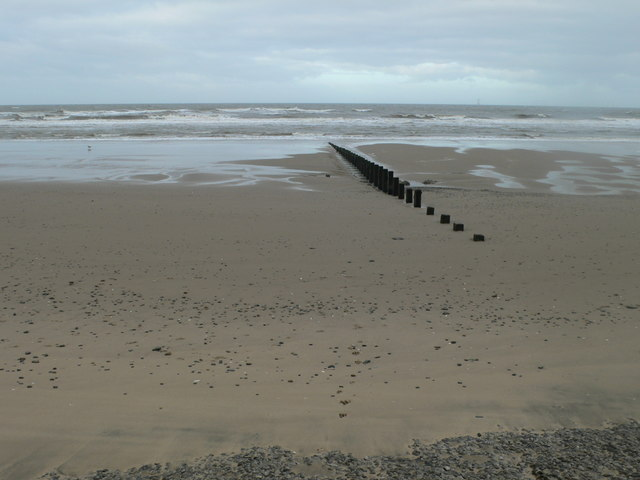 Wooden groynes heading out to the Irish Sea at Frith Beach