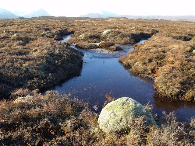 An unfrozen lead on Rannoch Moor in winter