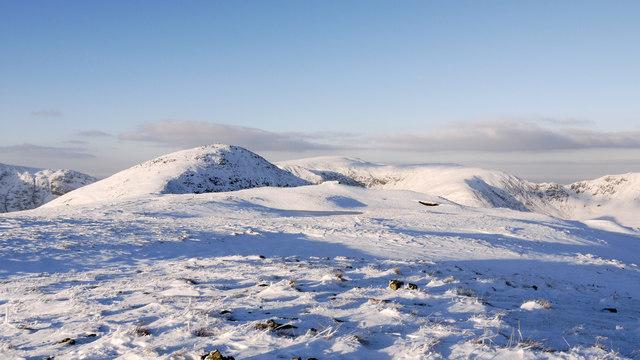Snowed slope north of summit of Yoke