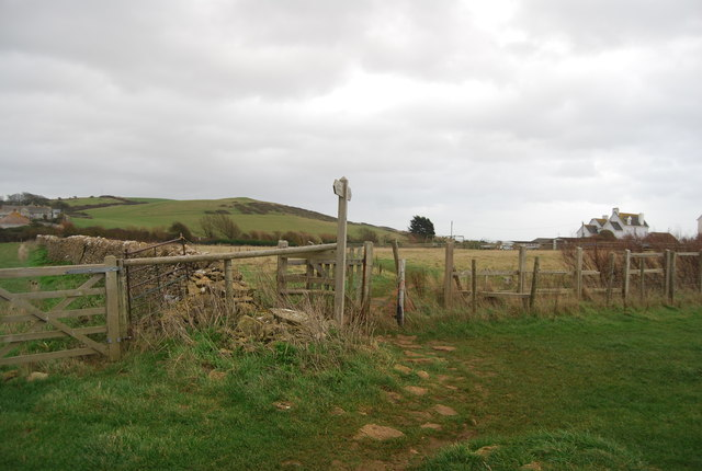 Footpath sign and stile