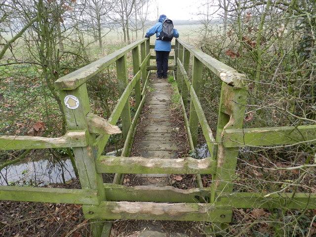 Footbridge and stile, thoroughly chewed