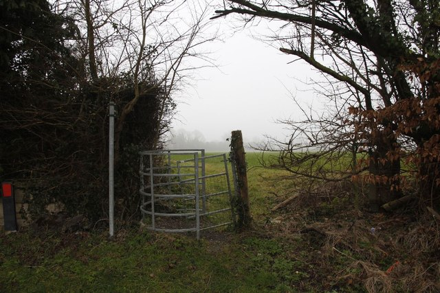 Kissing gate by the sign