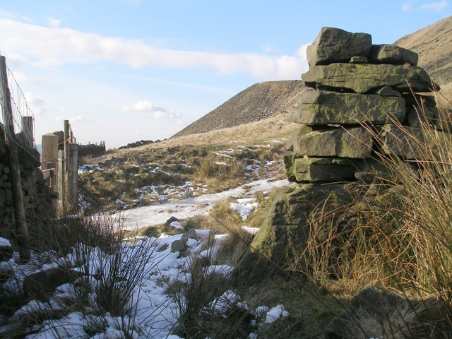 Cut benchmark beside the quarry track above Crowden