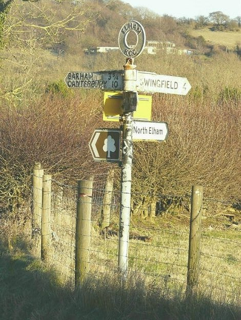 Close up of signpost at road junction