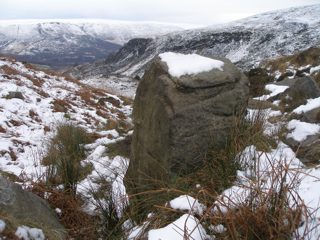 Cut benchmark on a boulder by the Pennine Way near Oaken Clough