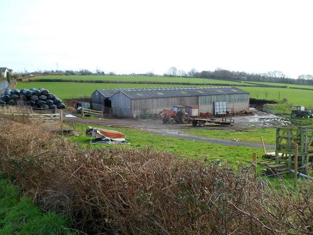 Farm buildings and black storage bags, Sluvad Road east of New Inn