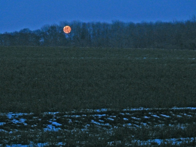 Moonrise over icy fields