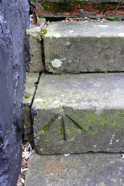 Benchmark on the steps to the Hart of Harwell pub