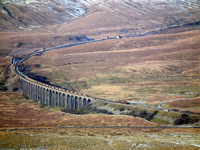 A coal train heads south over Ribblehead Viaduct