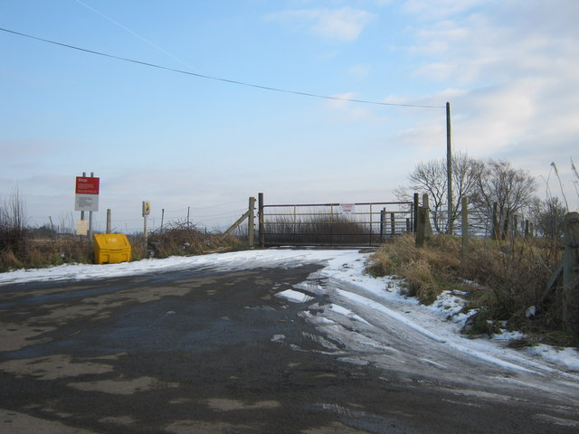 Road to level crossing giving access to West Brocks and White House farmsteads