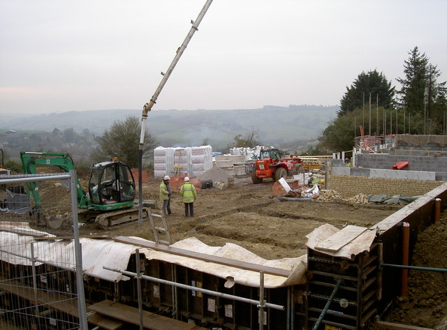 Concrete pouring into the footings