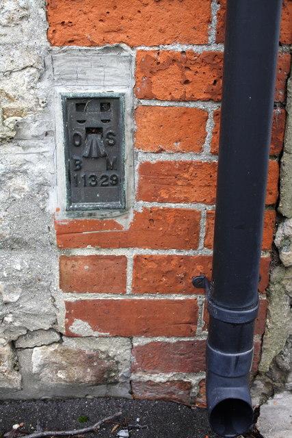 Benchmark on Corner House, Church Green