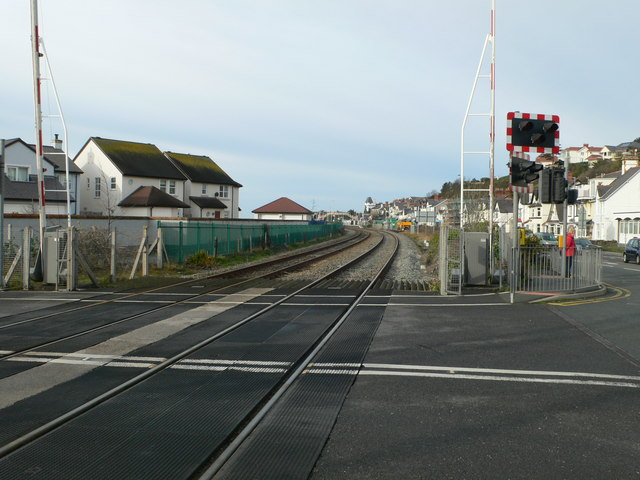 The road to Deganwy Harbour crosses the railway line