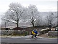 NY9942 : Cyclists passing Weather Hill by Oliver Dixon